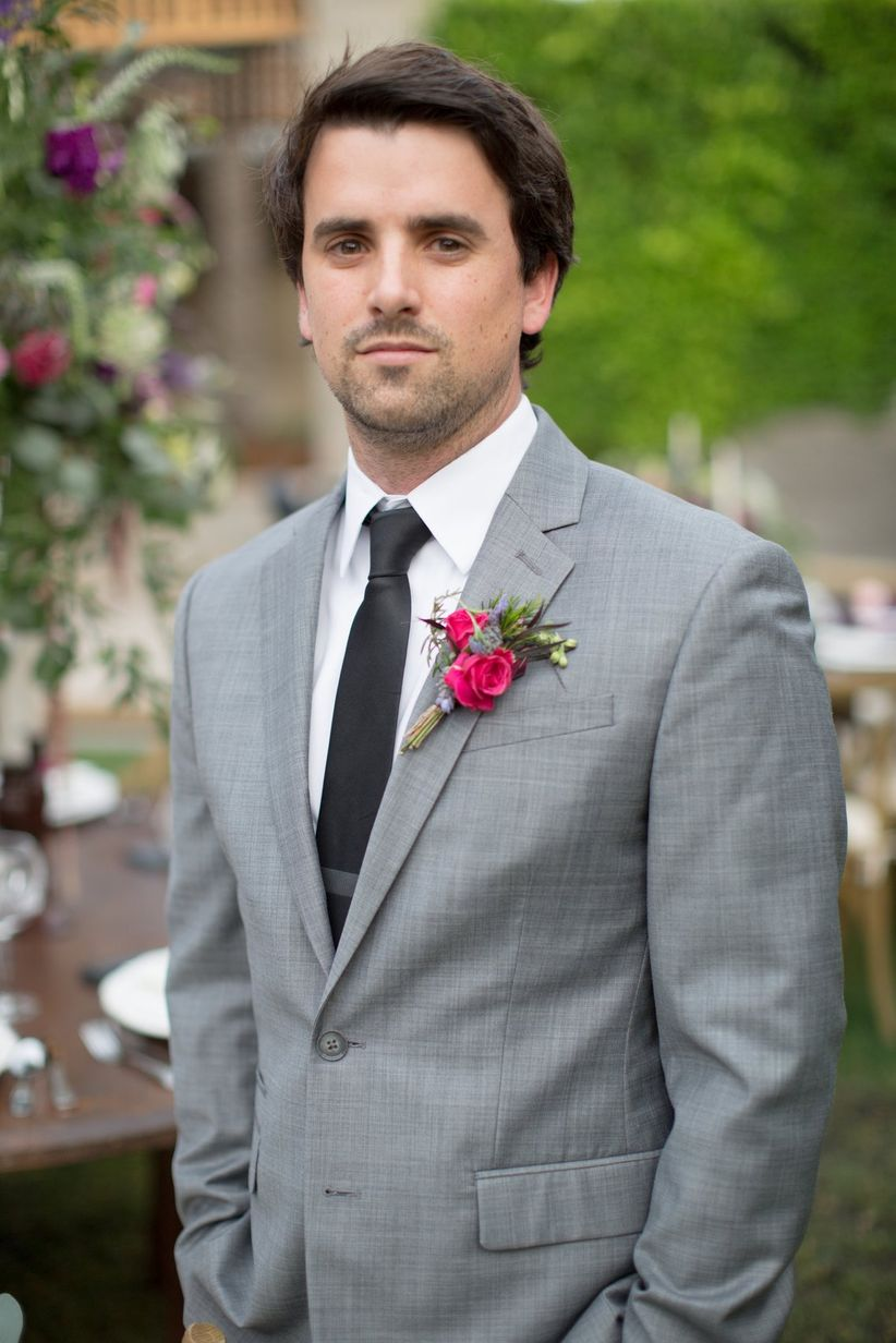 groom in gray suit with black tie