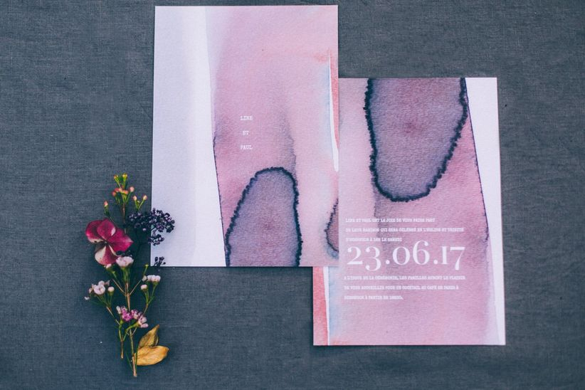 purple ultra violet invitations with a watercolor pattern on a concrete background