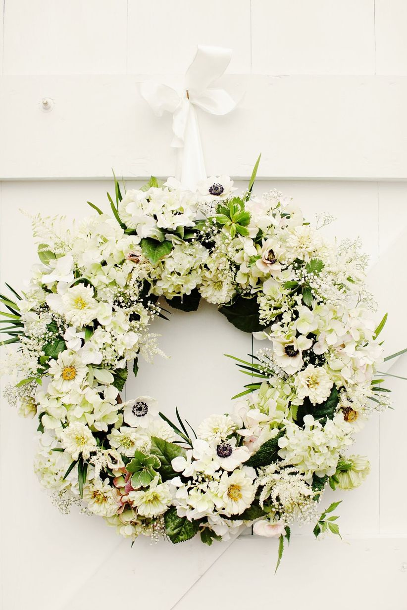 rustic wedding wreath with white and yellow flowers