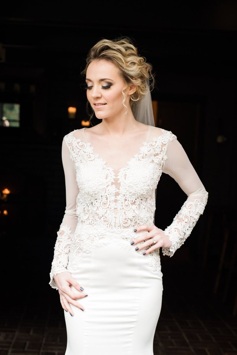 bride in wedding dress with illusion lace sleeves