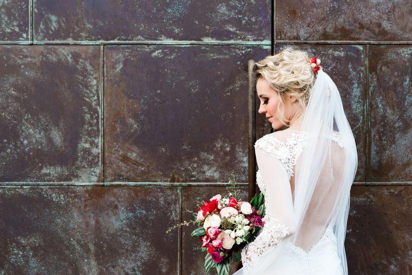 bride wearing wedding dress with open back