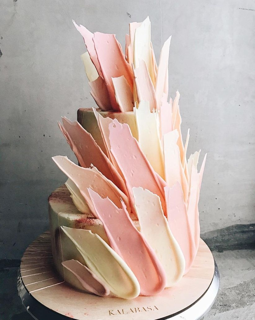 trendy brushstroke wedding cake with blush and ivory colors