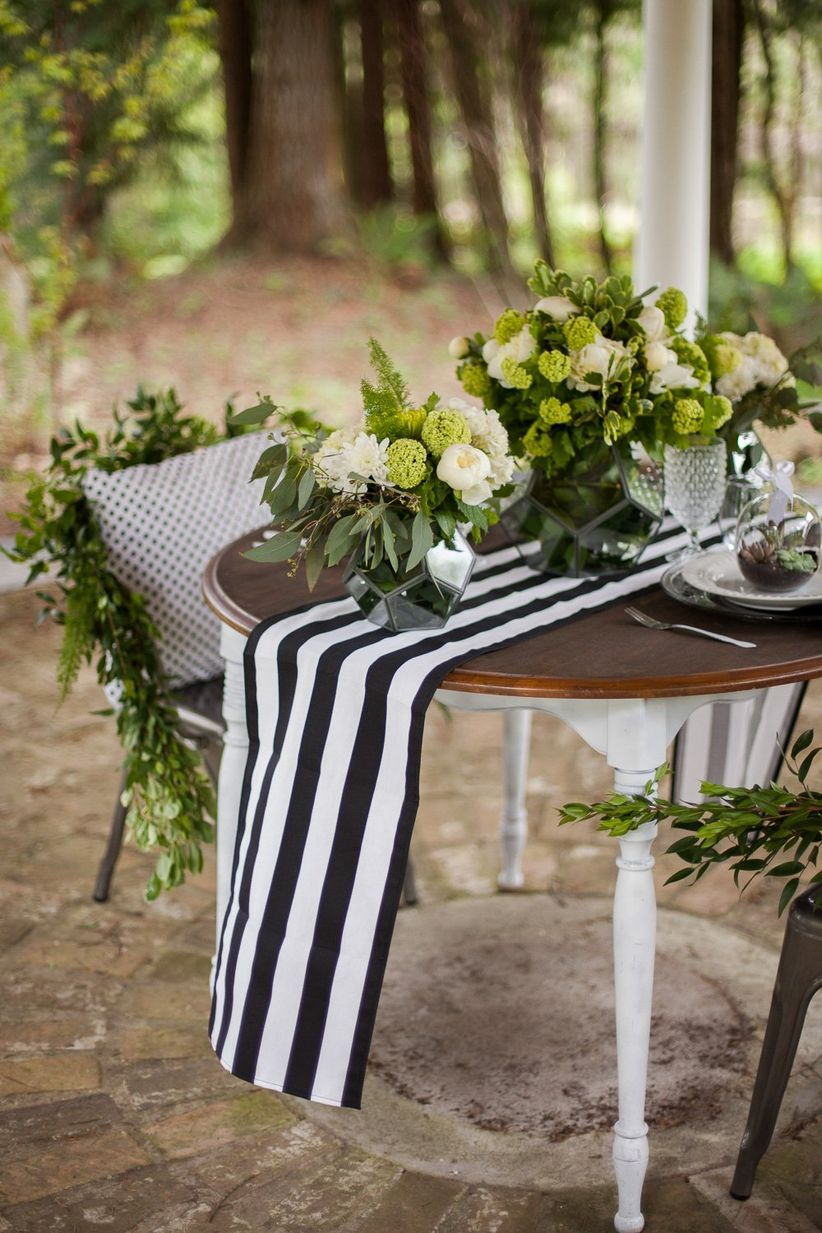 modern sweetheart table with black and white details