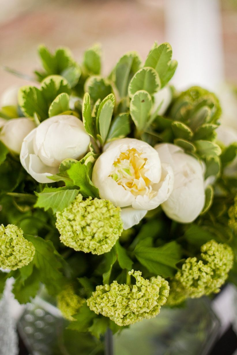 white peony centerpiece with greenery