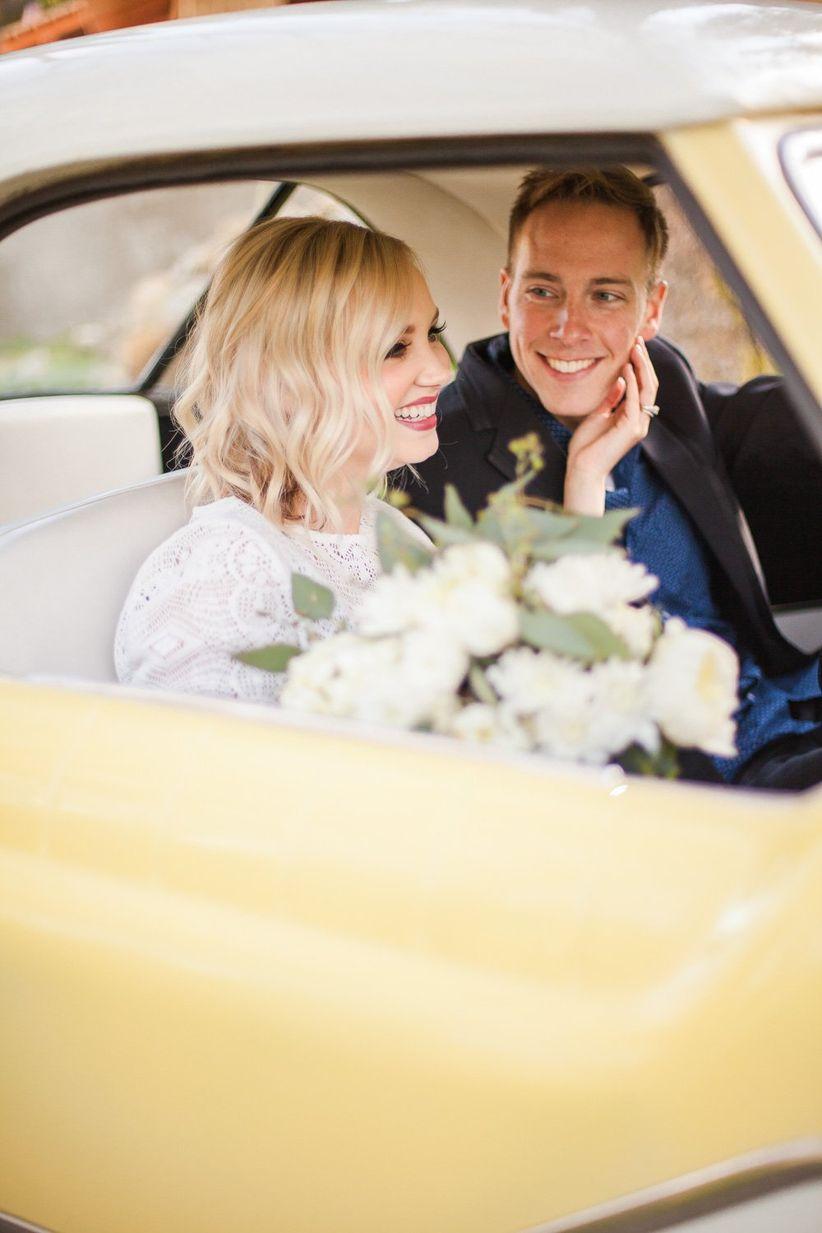 bride and groom inside getaway car