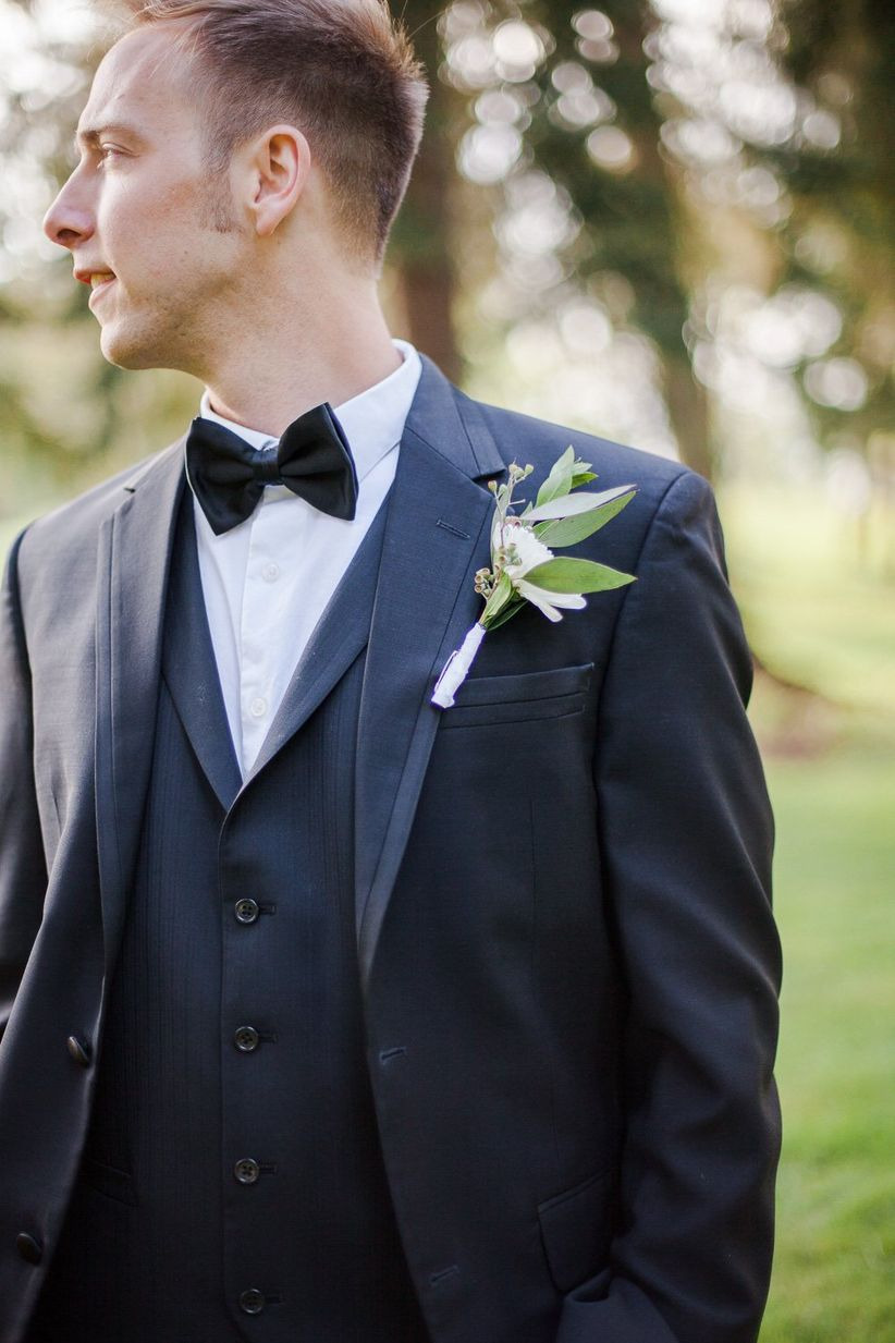 groom's tuxedo with bow tie and boutonniere