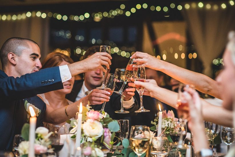 wedding party toasting during reception