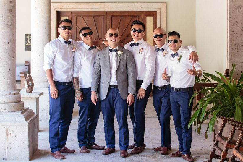 Groom and Groomsen white button down dark blue slacks matching bow tie