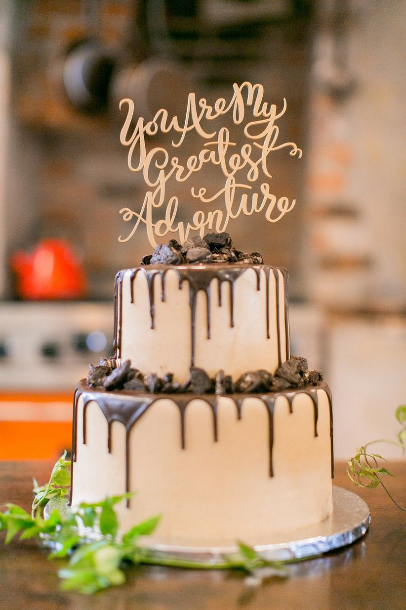 The 11 types of wedding cake toppers you need to know weddingwire laser cut cake topper junglespirit Choice Image