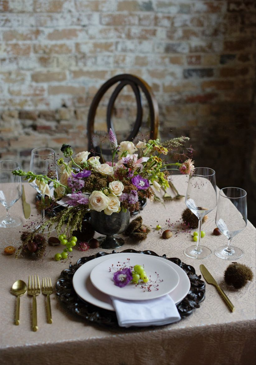 ultra violet purple wedding centerpiece idea with roses and greenery