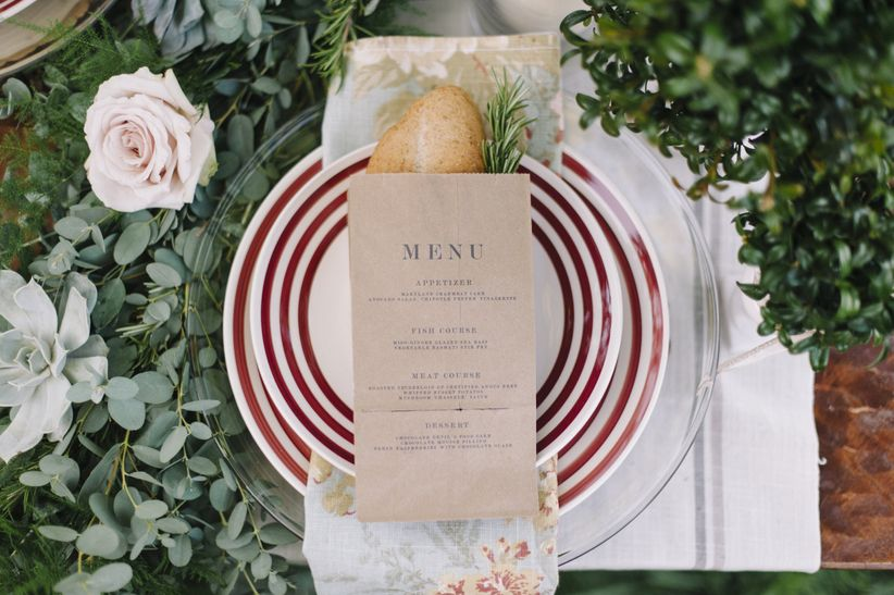 close up striped china menu and floral napkins