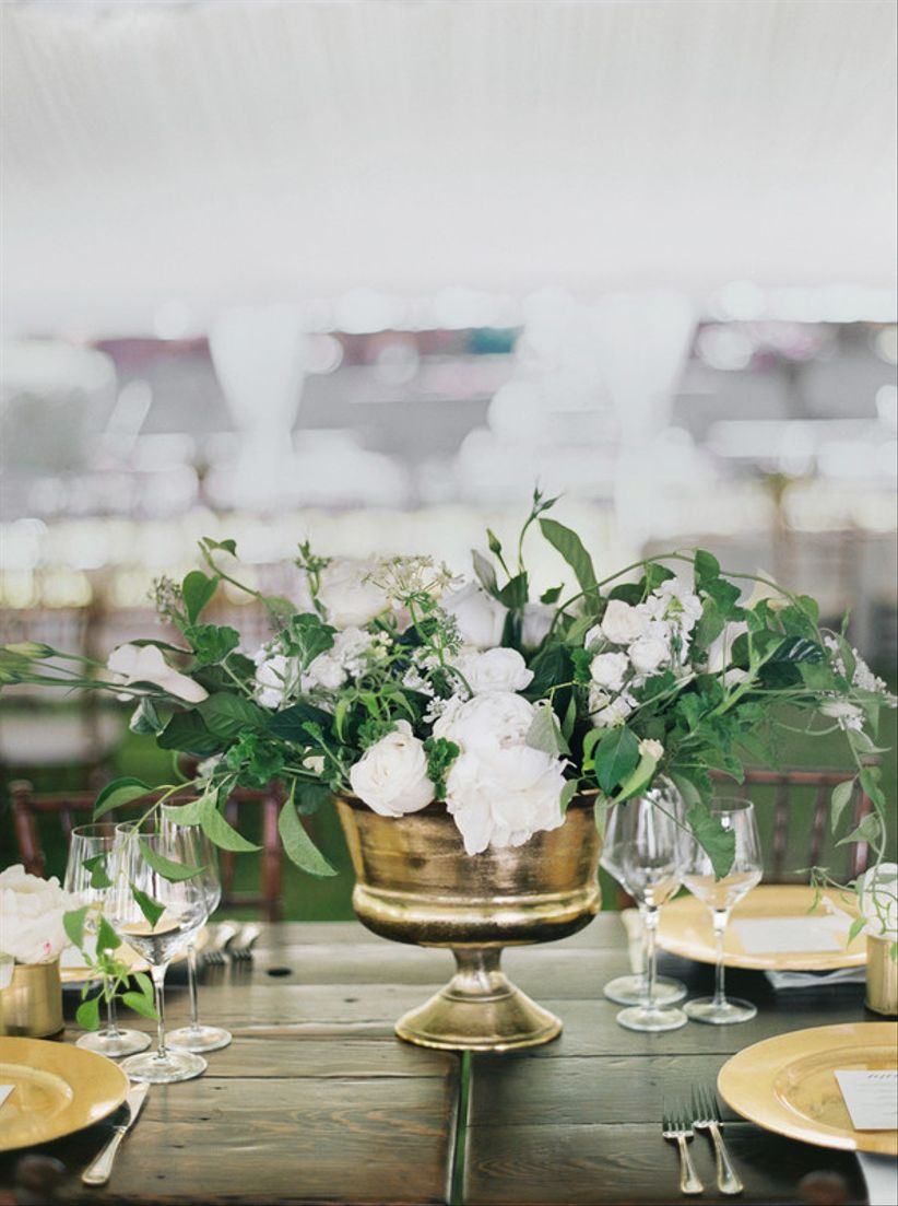 classic wedding centerpiece with white flowers and loose greenery
