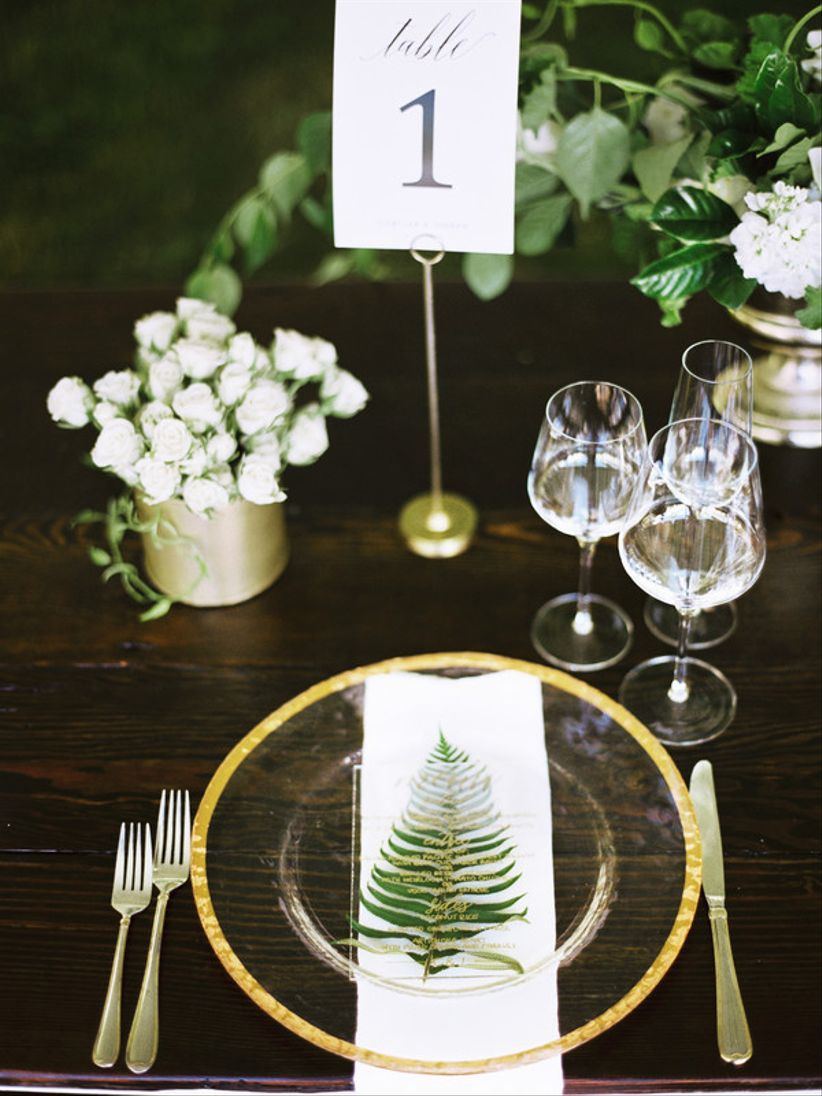 woodland wedding idea —fern leaf and menu card at gold and white place setting
