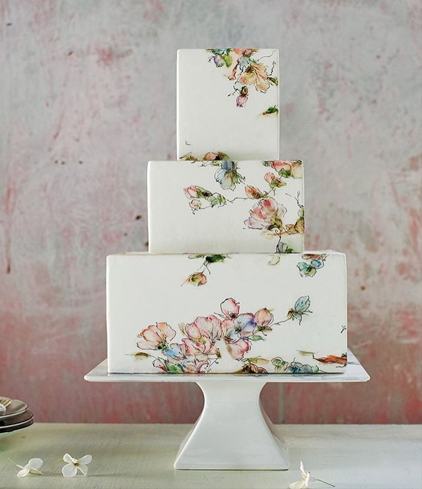 romantic hand-painted wedding cake with watercolor flowers