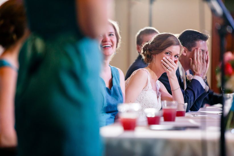 embarrassed bride during maid of honor toast
