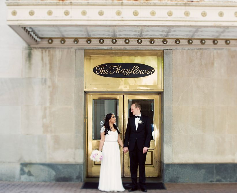 bride and groom in front of mayflower hotel