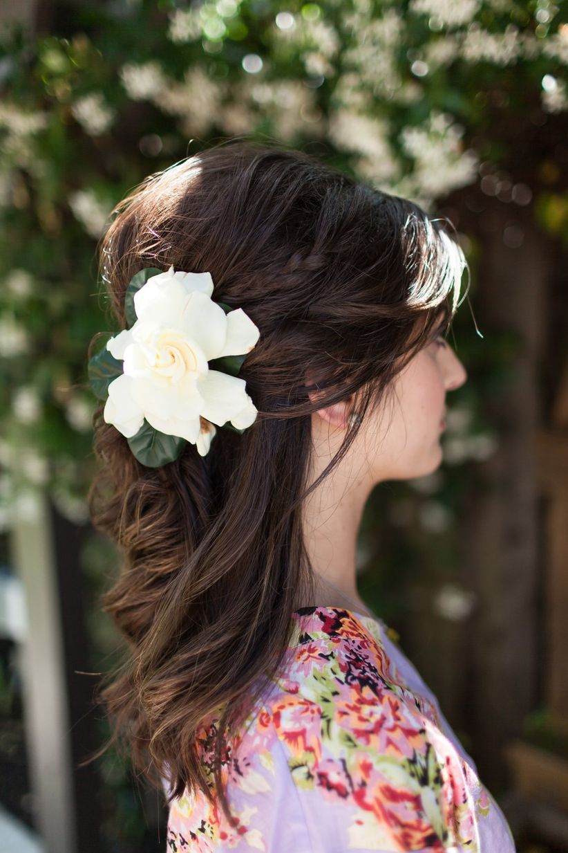 half-up wedding hairstyle with flowers