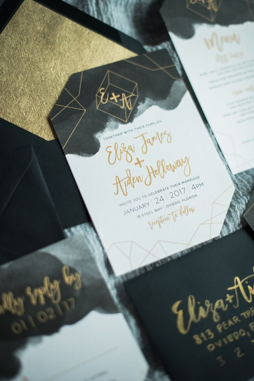 black and gold wedding invitation