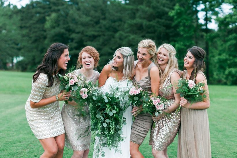 boho bride with bridesmaids wearing short gold dresses
