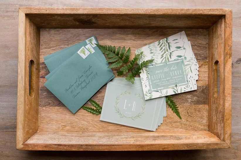 modern rustic wedding invitations decorated with greenery motifs