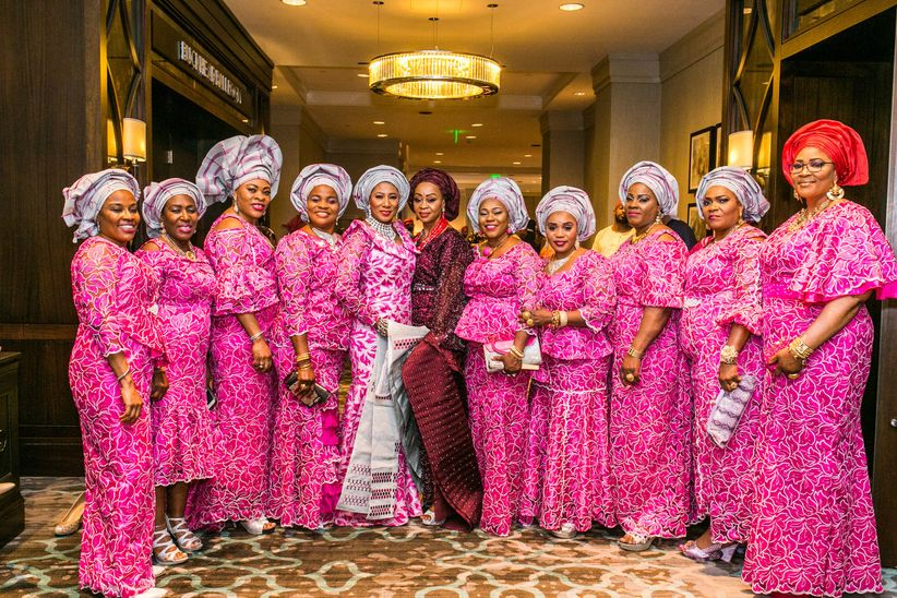 363a487e8f0858 ... aso ebi styles run the gamut from belted dresses to two-piece dresses  to blouse and skirt combinations. This bridal party is also perfectly  matched to ...