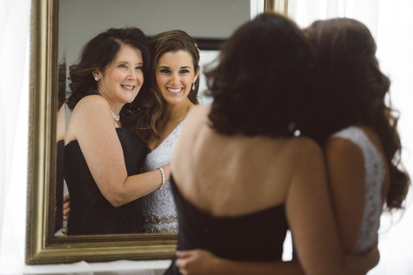 bride and mother of the bride looking in mirror tyler boye photography