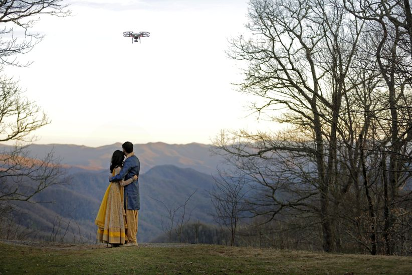 wedding couple with drone