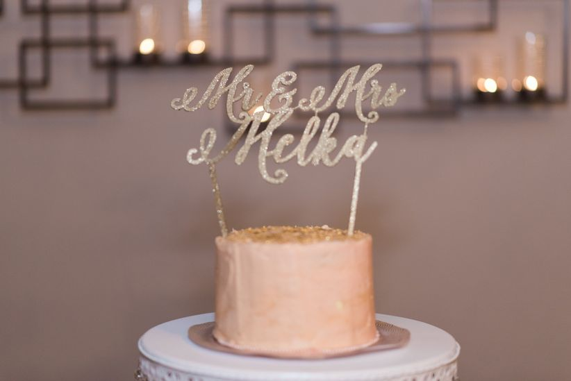 single tier cake with laser cut topper and buttercream frosting