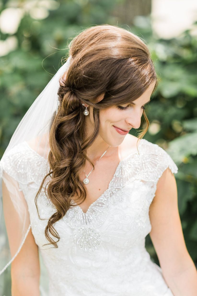 10 wedding hairstyles for long hair you 39 ll def want to steal weddingwire. Black Bedroom Furniture Sets. Home Design Ideas
