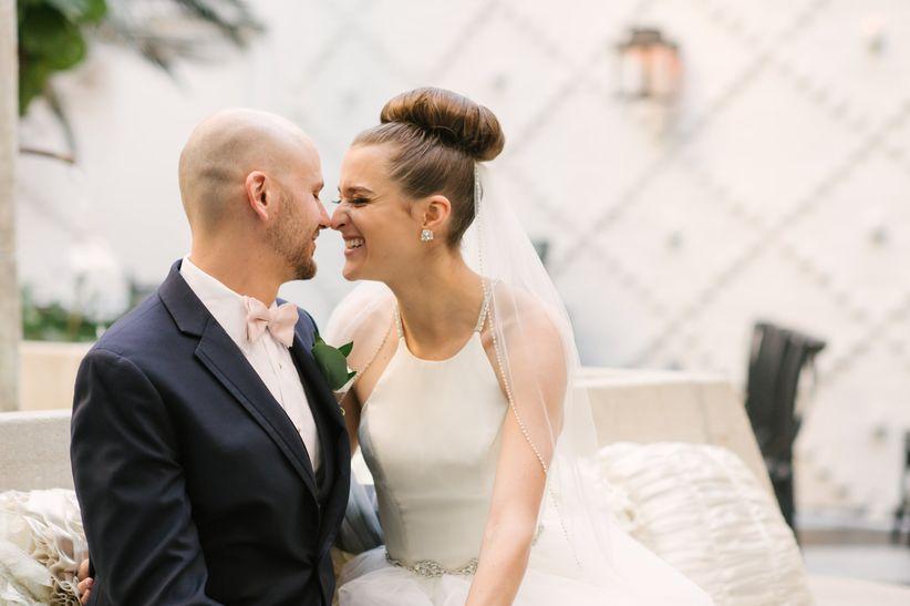 nuzzling wedding couple