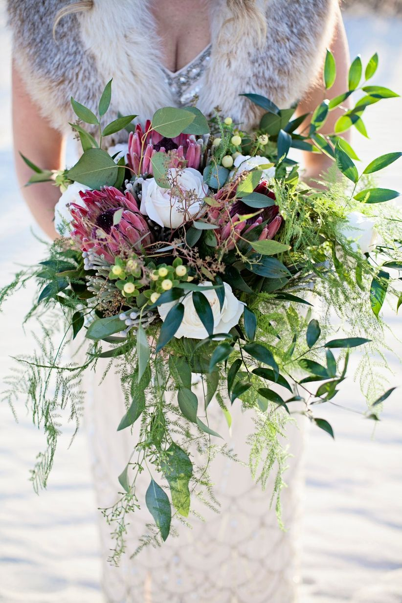 wedding bouquet with proteas and greenery