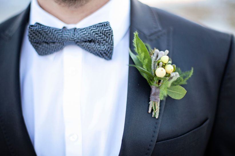 groom wearing herringbone bow tie
