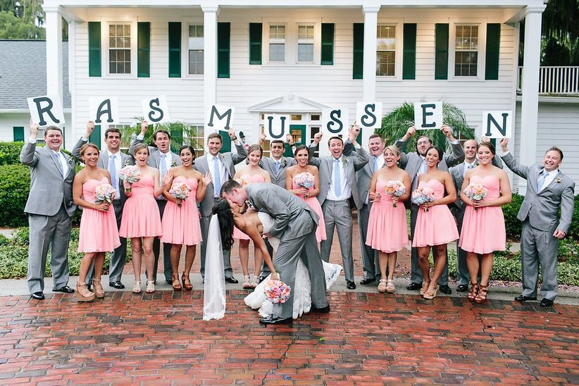 wedding party holding signs