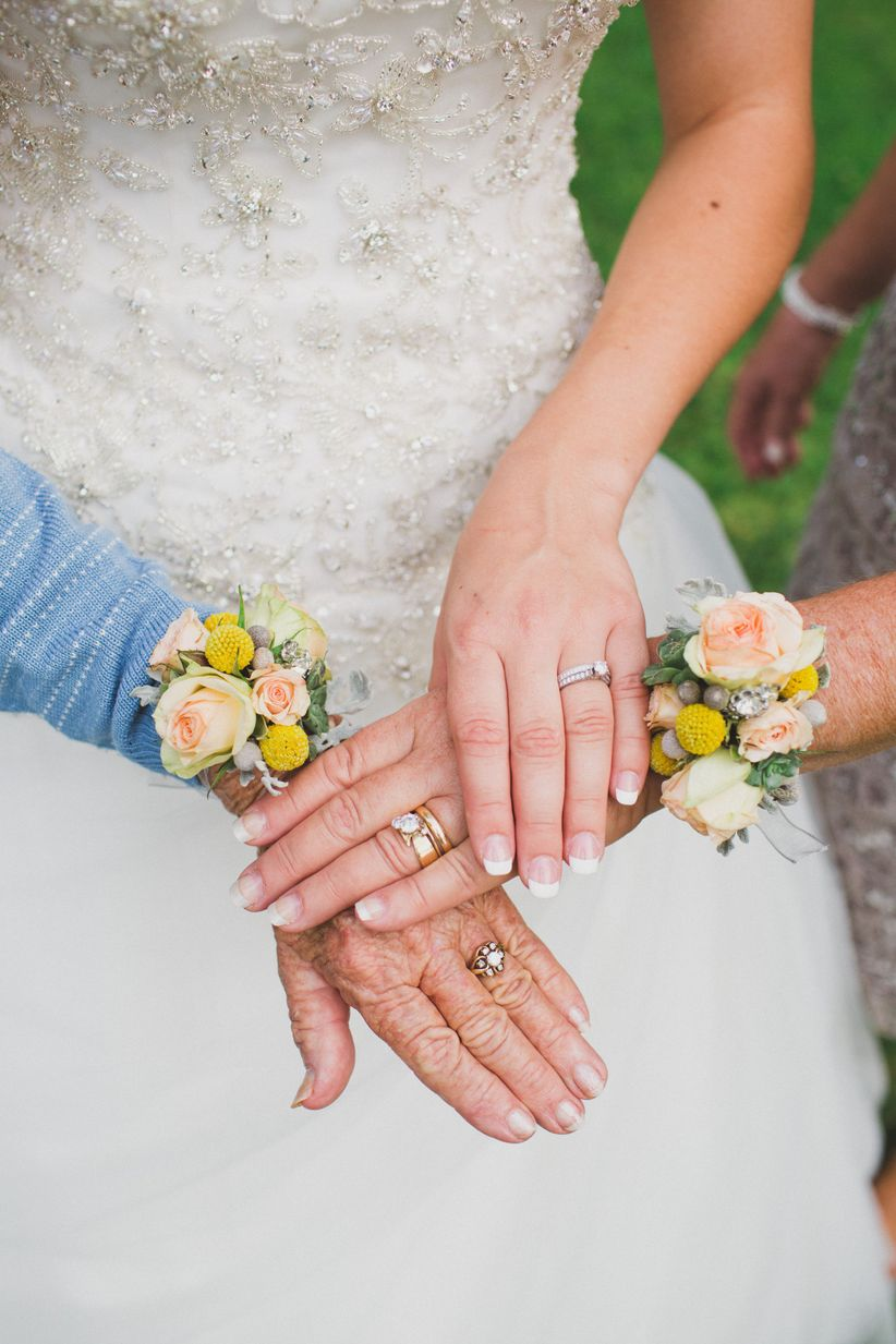 bride mother and grandmother pose with their wedding rings