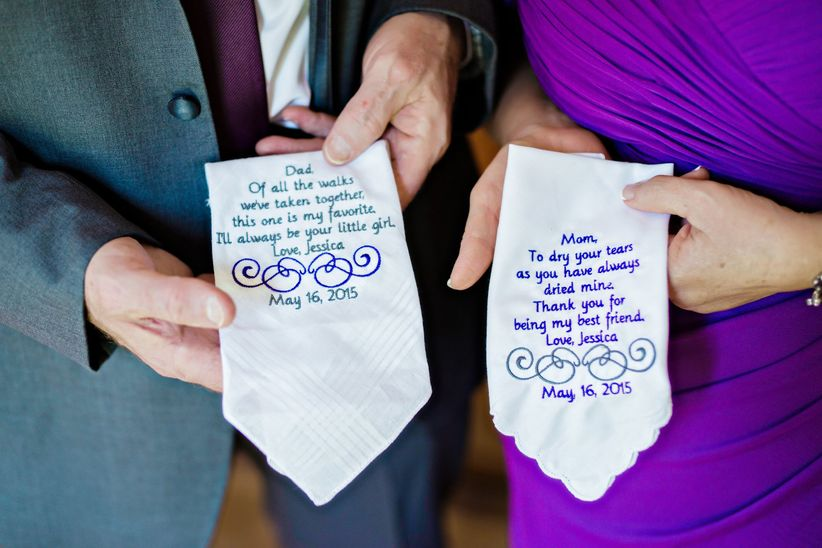 parents of the bride holding personalized handkerchiefs