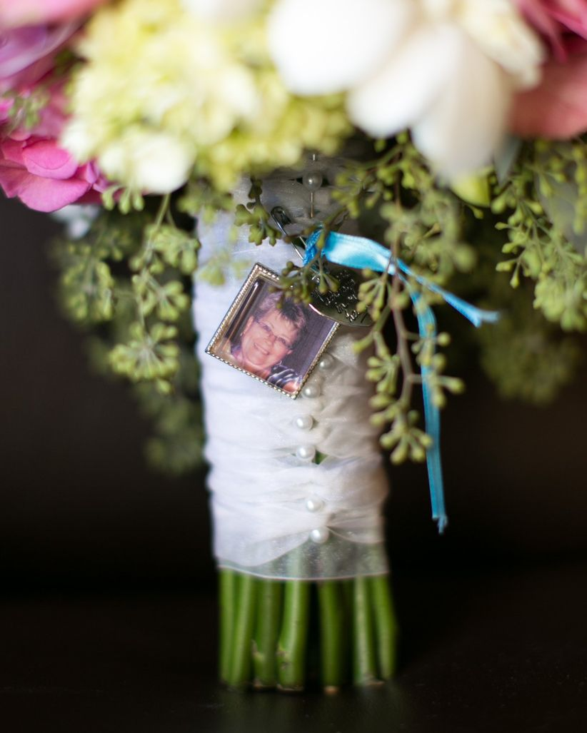 image of loved one attached to bride bouquet