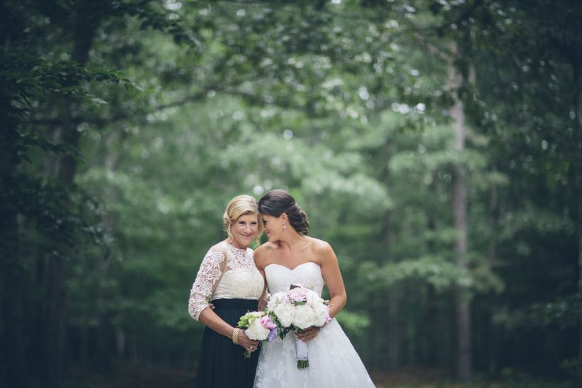 bride and her mom share a hug