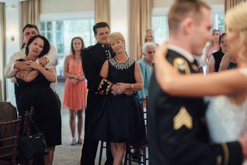 parents watch newlyweds' during first dance