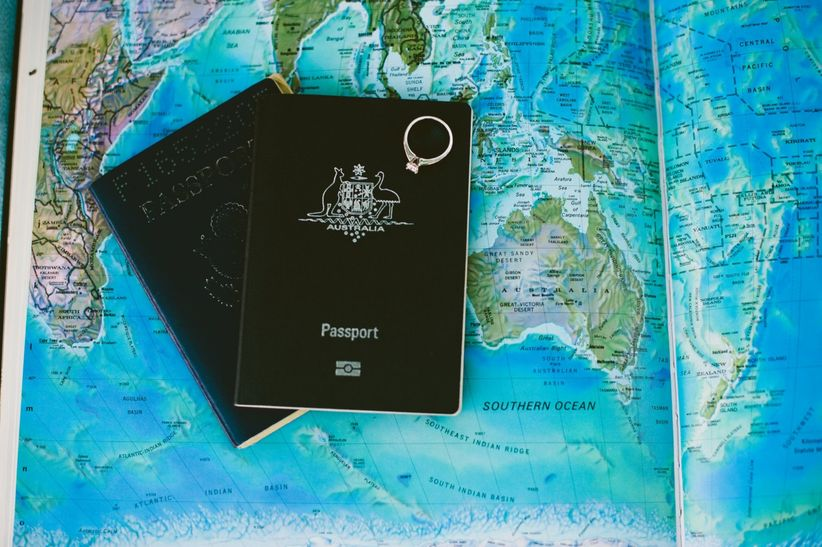 passports and engagement ring