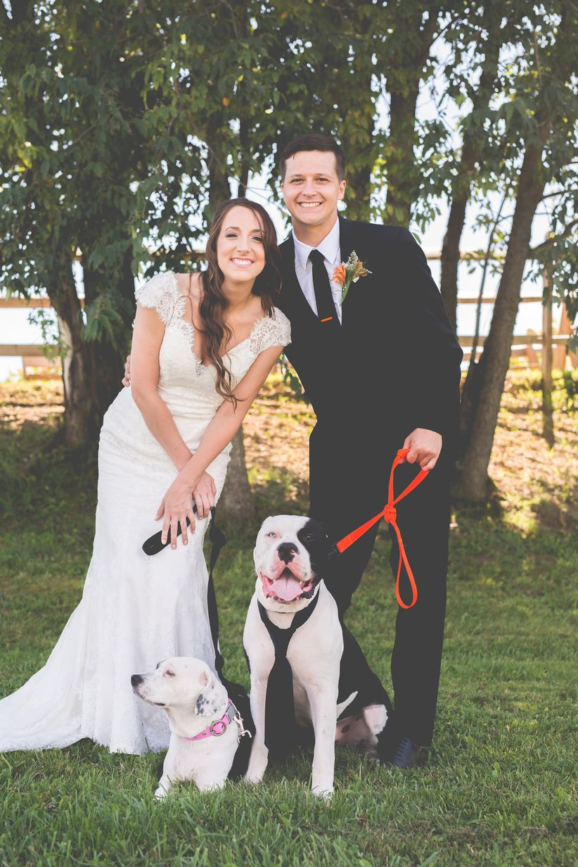 couple with dog on leash