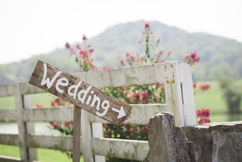 rustic wedding sign - what's your wedding planning anthem - rebecca denton photography