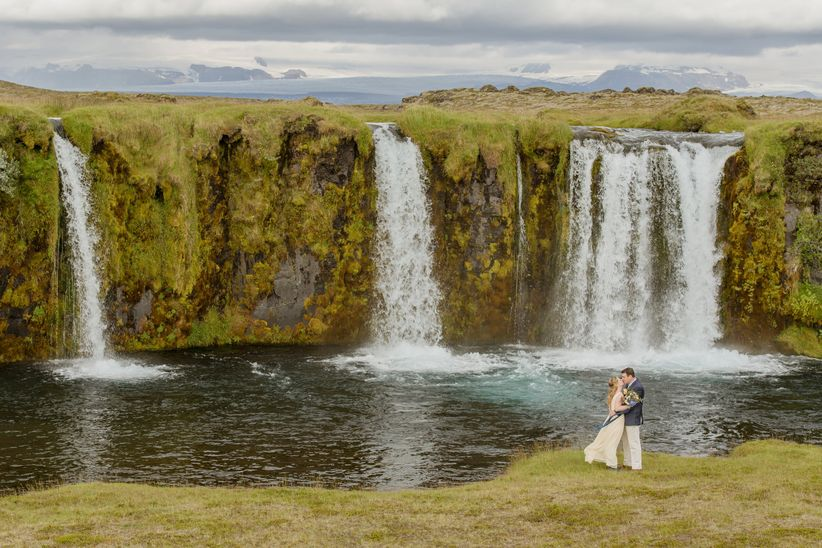 couple posing with scenic waterfall backdrop