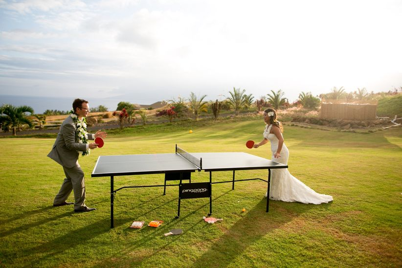Couple playing ping pong outdoor reception joanna tano photography