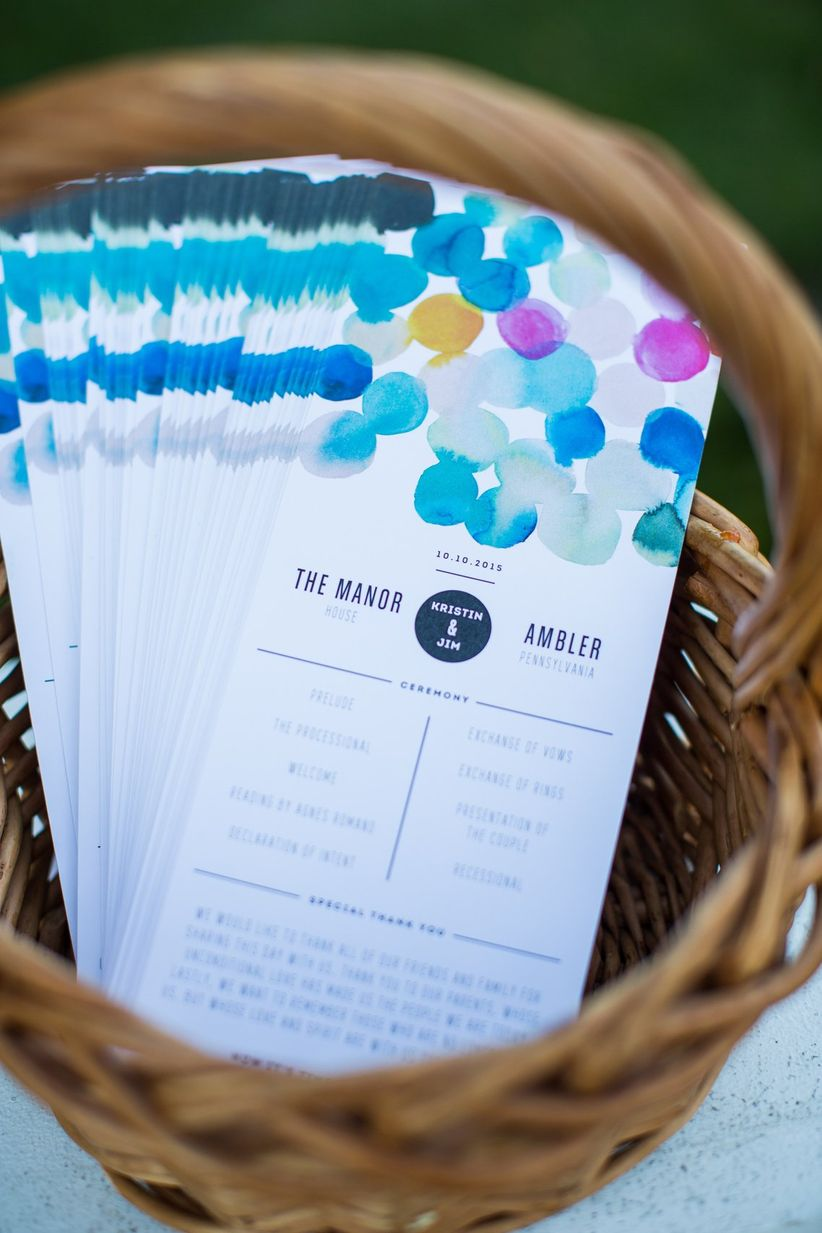 wedding ceremony programs decorated with colorful watercolor polka dots