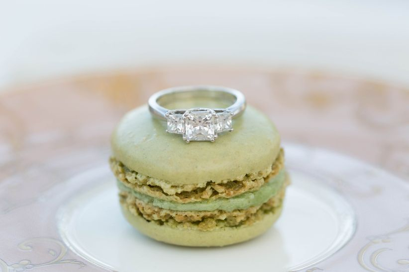engagement ring displayed with dessert