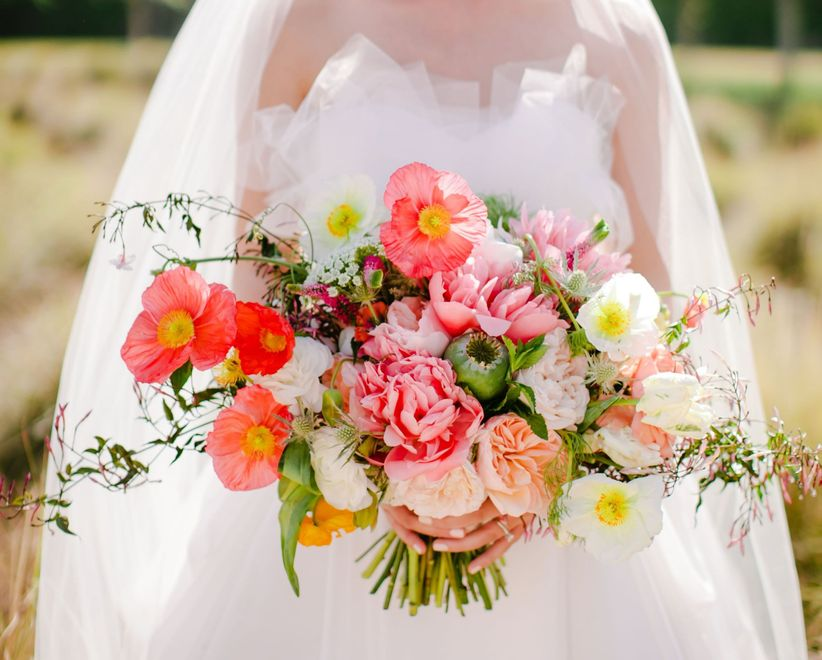 10 spring wedding flowers we love weddingwire pink poppy and peony bouquet junglespirit Image collections