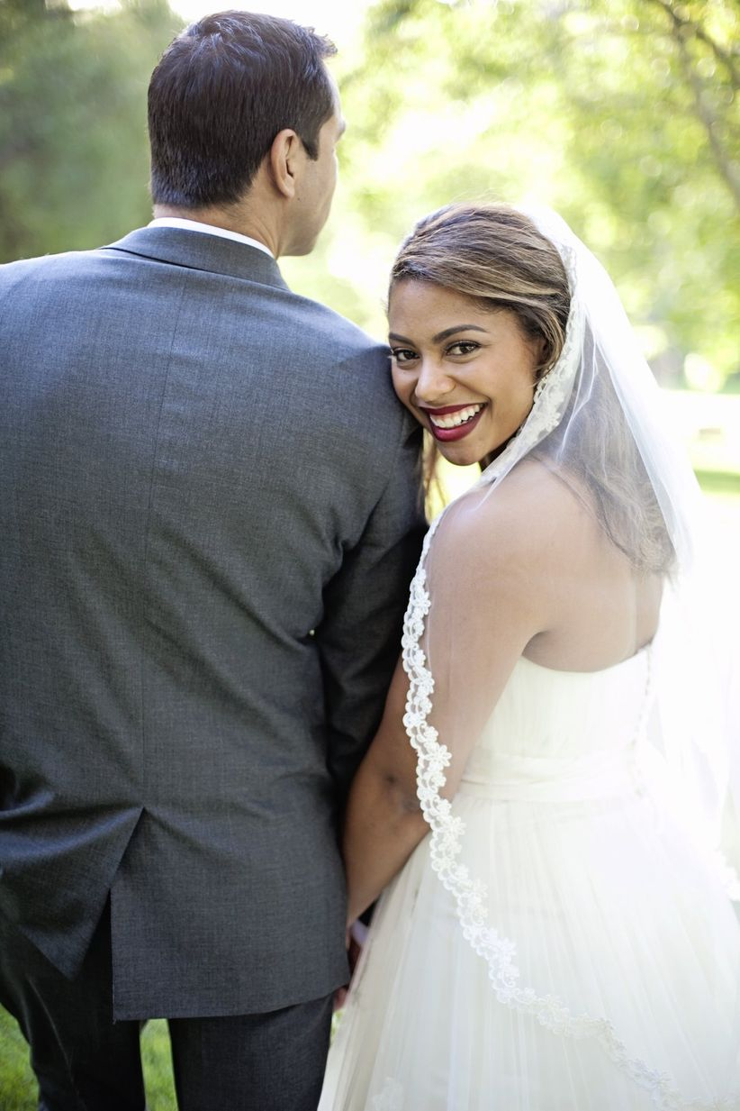cute bride and groom pose