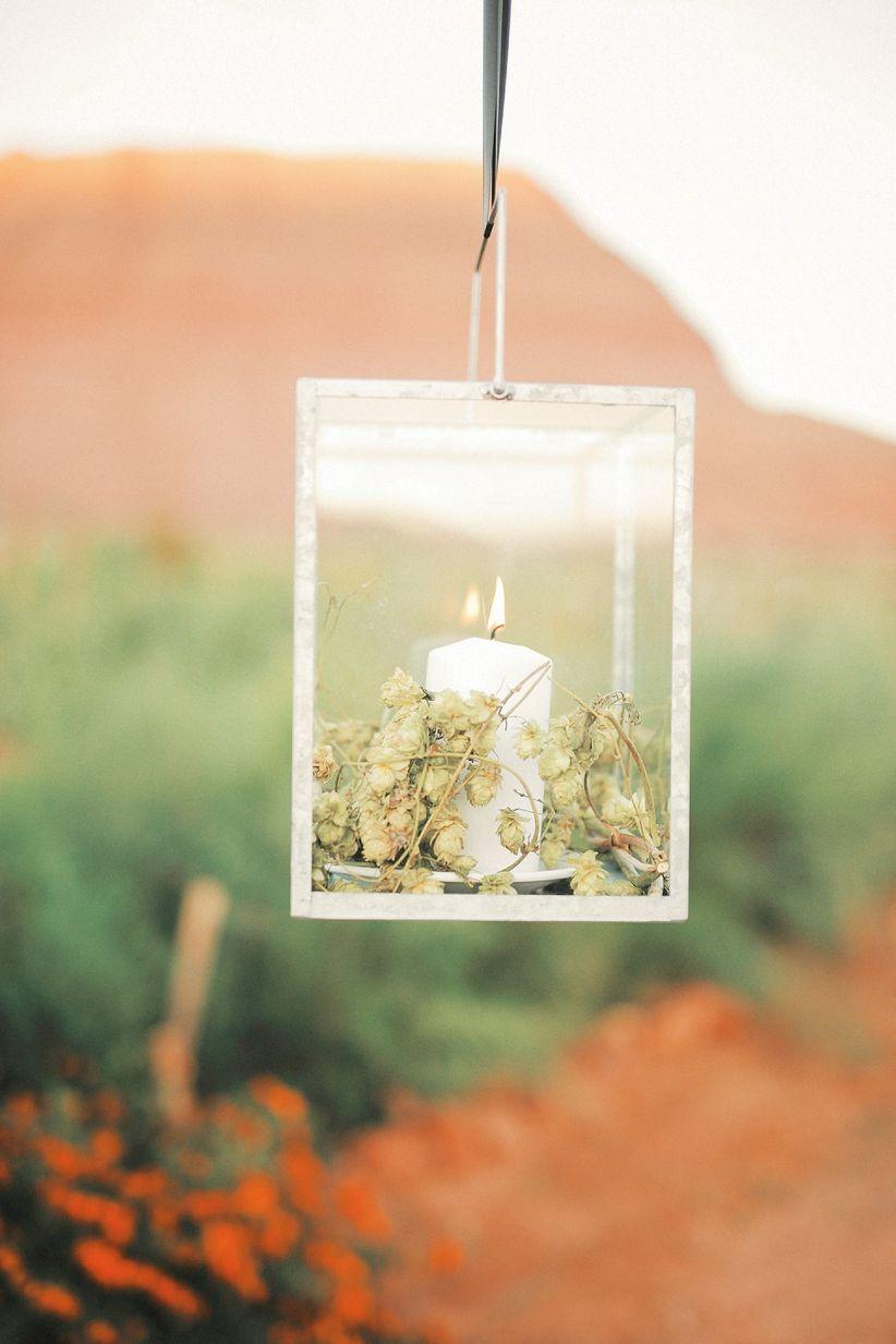 hanging candlelit lanterns for wedding reception
