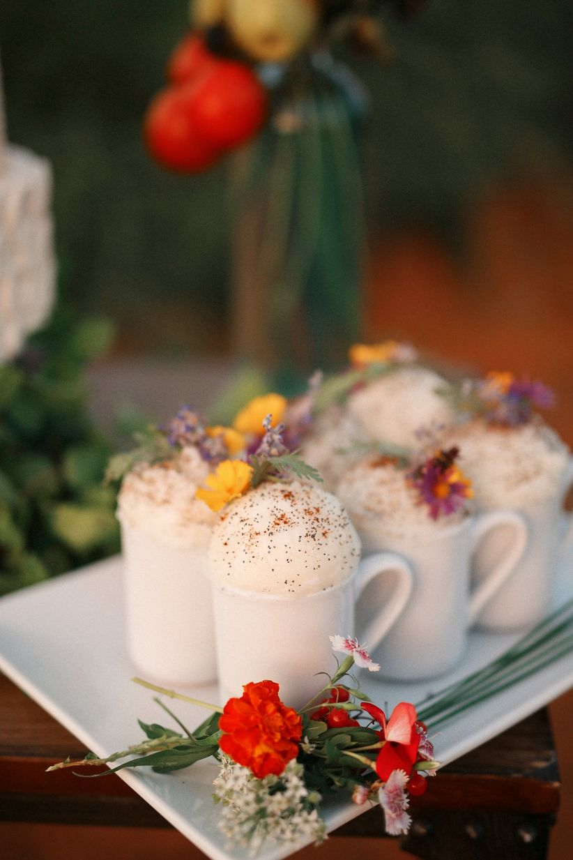 coffee drinks garnished with fresh flowers