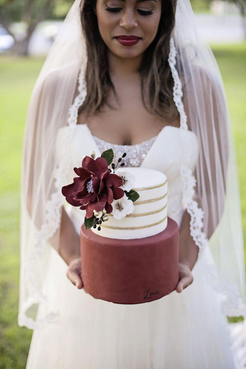 romantic gold and burgundy fondant wedding cake